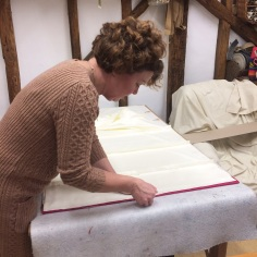 A class member working on the lining of a Roman blind