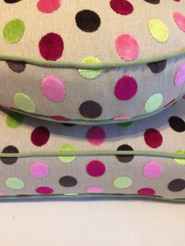 The fabric has been pattern matched perfectly on these rectangular and circular box cushion covers