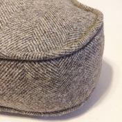 Gorgeous herringbone wool makes a curvaceous box cushion cover